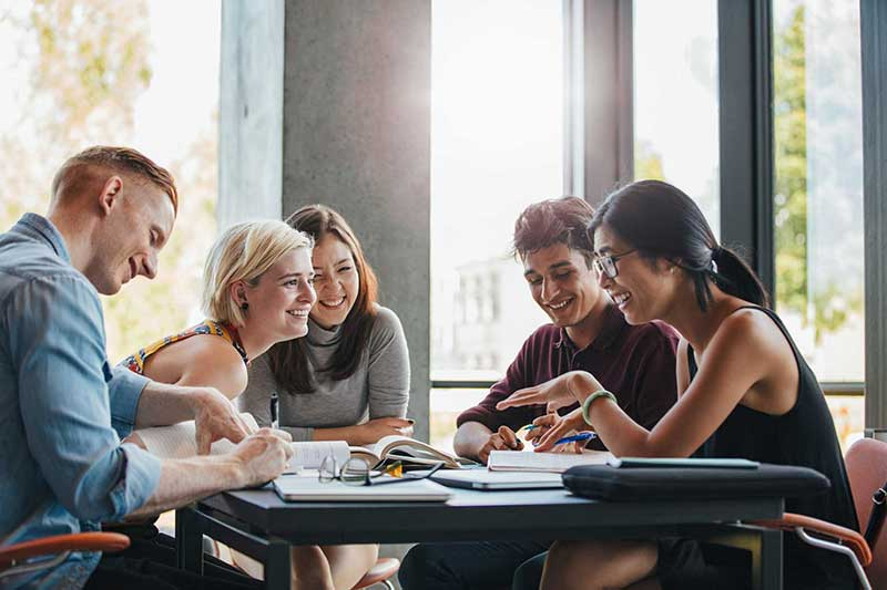Friends at a table studying