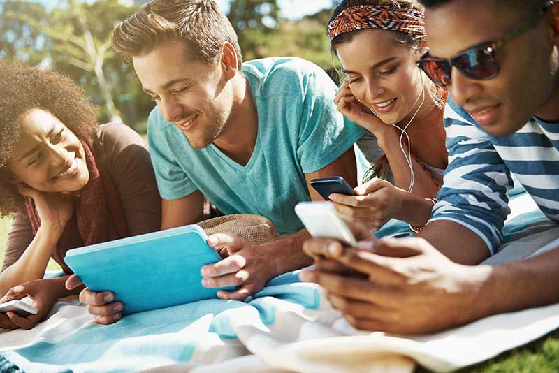 Friends laying down at the park