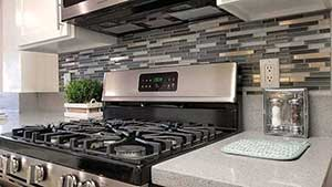 Close up of kitchen stove and back splash