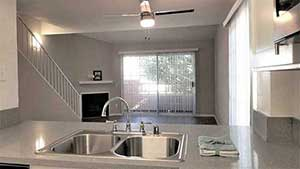 Living room and stairs from kitchen