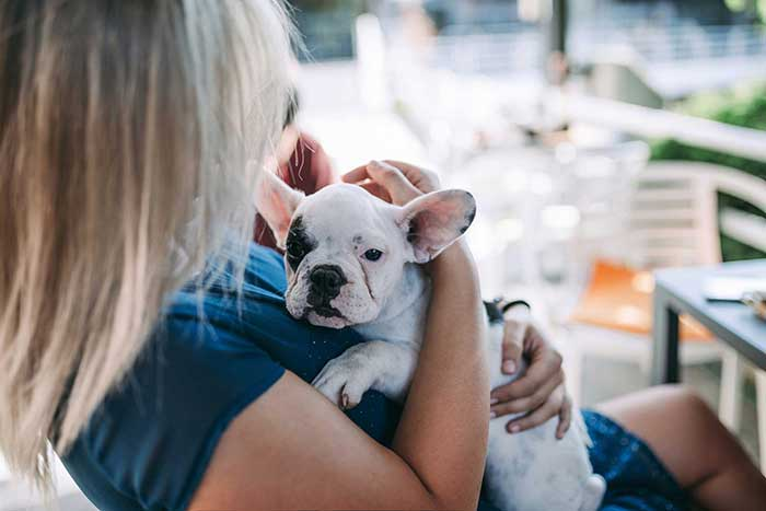 Woman holding her puppy